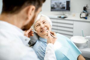 Senior woman getting dental implants