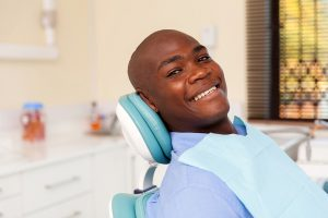 African American man smiling in a dentist chair